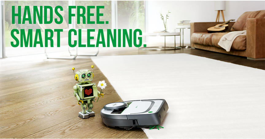 A small green Robot offers a daisy to a vacuum cleaner robot
