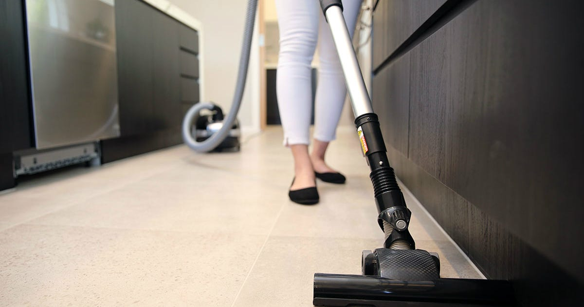 Woman learning how to use vacuum cleaner